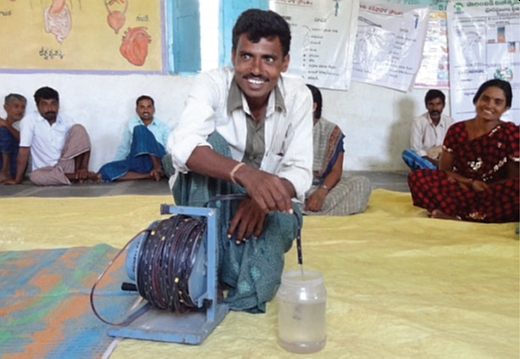 A farmer in India testing a groundwater dip meter (photo: Ruth Meinzen-Dick).